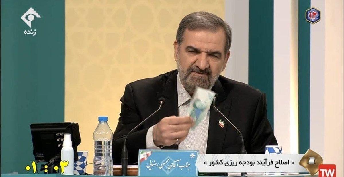 محسن رضایی دوباره با نمایش هزار تومانی مناظره را آغاز کرد
