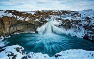 عکس روز به انتخاب نشنال جئوگرافیک آبشار یخ زده، ایسلند
