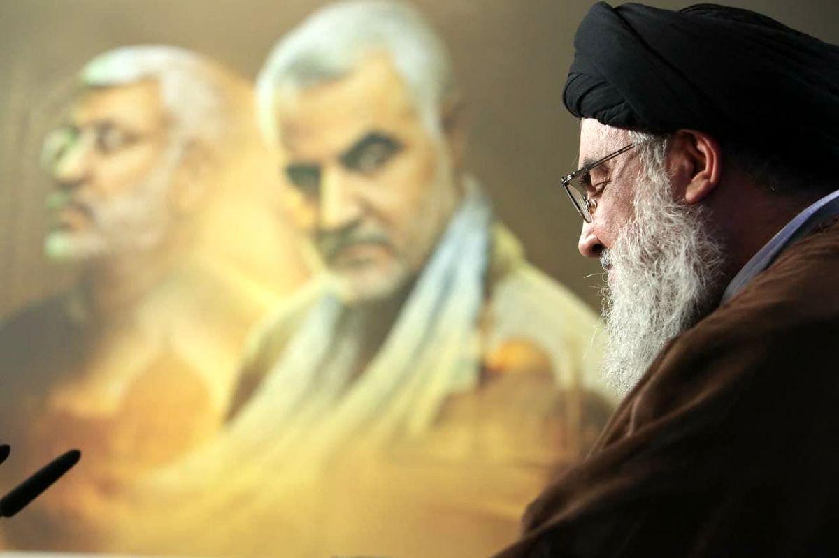 تصویری زیبا از نگاه شهید سردار سلیمانی به سید حسن نصرالله