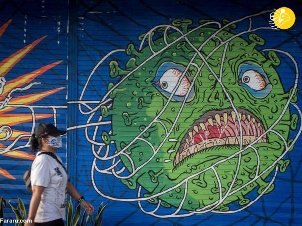 نقاشیهای عجیب دیواری با الهام از کرونا +عکسها